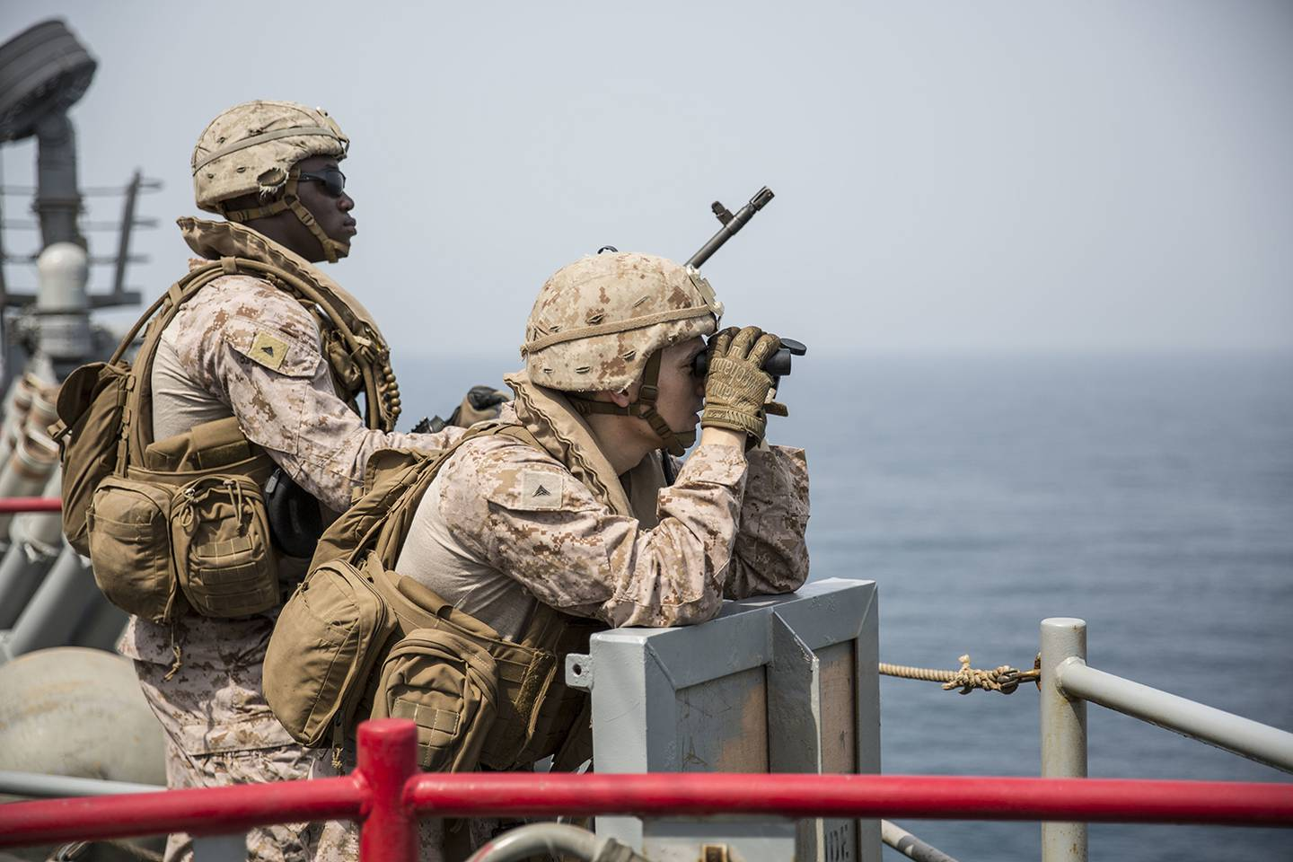 Marines provide security aboard the amphibious dock landing ship USS Harpers Ferry (LSD 49) on July 23, 2019, during a Strait of Hormuz transit.