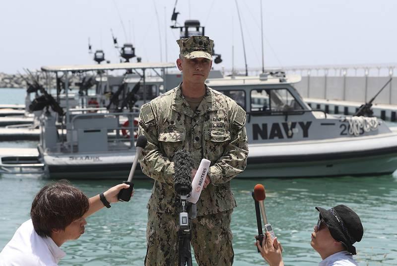 Cmdr. Sean Kido of the U.S. Navy's 5th Fleet talks to journalists