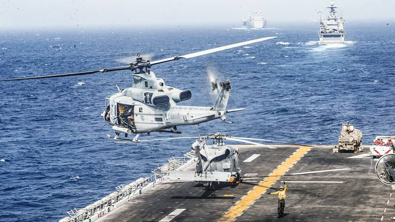 A UH-1Y Venom helicopter  takes off from the flight deck of the amphibious assault ship USS Boxer (LHD 4) on July 18, 2019, during a Strait of Hormuz transit.