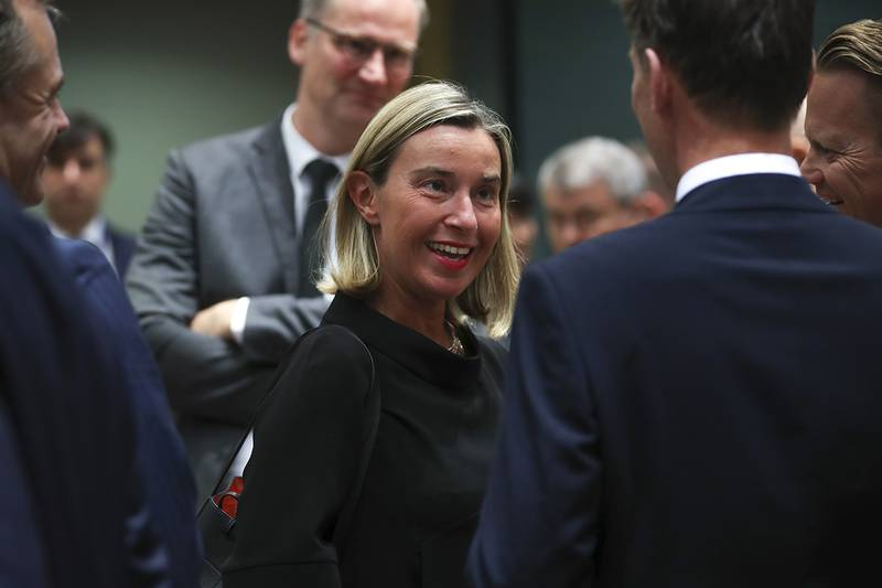 European Union foreign policy chief Federica Mogherini, center, arrives for a European Foreign Affairs Ministers meeting at the European Council headquarters in Brussels, Monday, July 15, 2019.