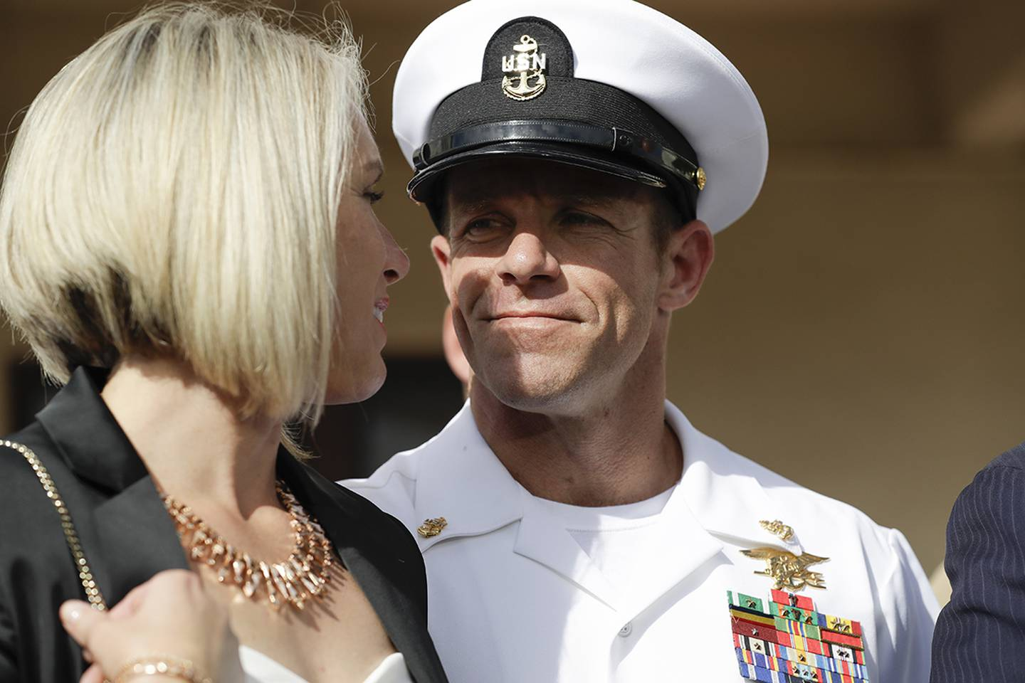 Navy Special Operations Chief Edward Gallagher, right, walks with his wife, Andrea Gallagher as they leave a military court on Naval Base San Diego, Tuesday, July 2, 2019, in San Diego.