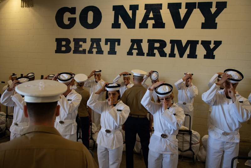 Plebes with the Class of 2023 don their covers at Induction Day on June 27, 2019, at the U.S. Naval Academy in Annapolis, Md.