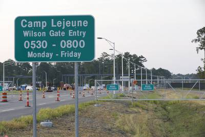 In this July 31, 2014, file photo, traffic moves onto Camp Lejeune in Jacksonville, N.C., as access to via the now open Wilson Gate goes into effect