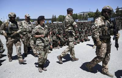 NATO forces attend the graduation ceremony of Afghan National Army soldiers