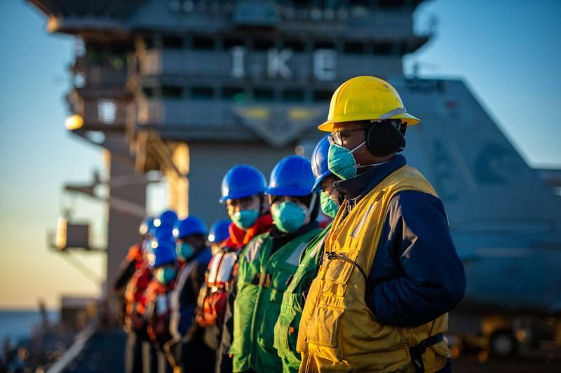 Sailors prepare for a replenishment-at-sea on Feb. 4, 2021, with the fleet-replenishment oiler USNS Kanawha (T-AO 196) onboard the Nimitz-class aircraft carrier USS Dwight D. Eisenhower (CVN 69) in the Atlantic Ocean.