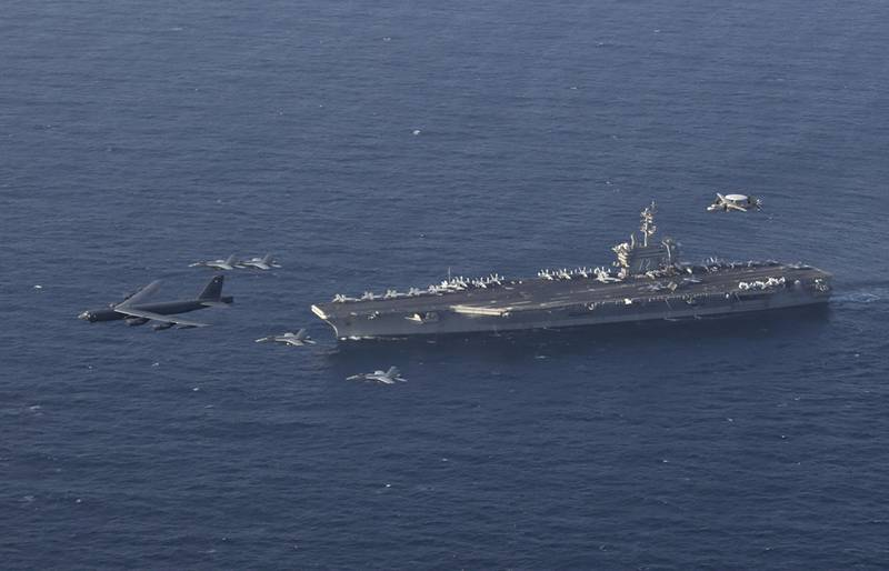 The Abraham Lincoln Carrier Strike Group and a U.S. Air Force B-52H Stratofortress conduct joint exercises in the Arabian Sea on June 1, 2019.
