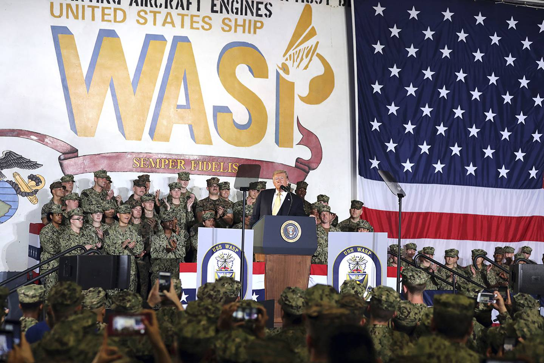 President Donald Trump speaks to U.S. servicemen aboard the amphibious assault ship USS Wasp at the U.S. Navy's Yokosuka base in Japan on May 28, 2019.