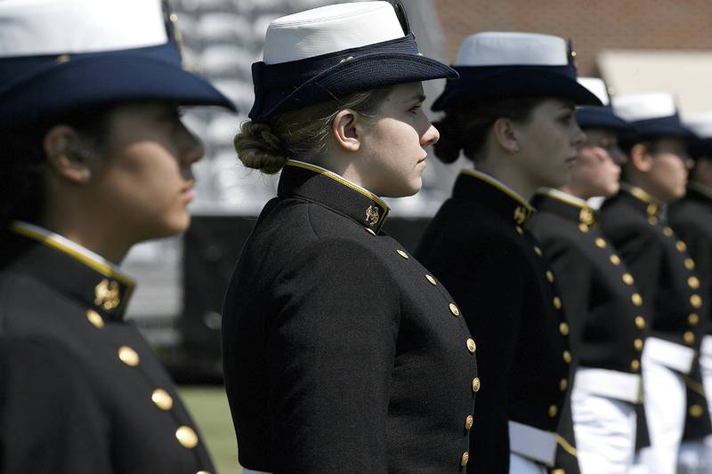 In this May 22, 2019, file photo, female cadets at the United States Coast Guard Academy line up during commencement in New London, Conn.