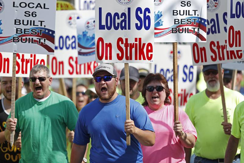 In this July 25, 2020 file photo, striking Bath Iron Works shipbuilders march in solidarity in Bath, Maine.