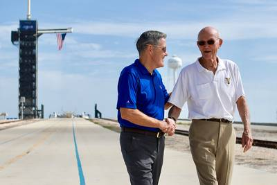 In this Tuesday, July 16, 2019 photo made available by NASA, astronaut Michael Collins, right, speaks to Kennedy Space Center Director Bob Cabana at Launch Complex 39A, about the moments leading up to launch at 9:32 a.m. on July 16, 1969, and what it was like to be part of the first mission to land on the moon.