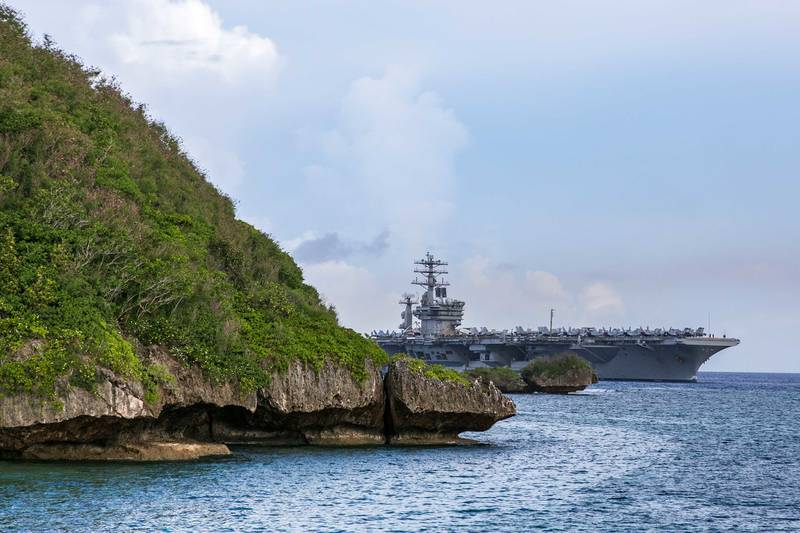 The aircraft carrier USS Nimitz (CVN 68) passes Point Udall as it enters Apra Harbor on June 24, 2020, prior to mooring at Naval Base Guam for a scheduled port visit.