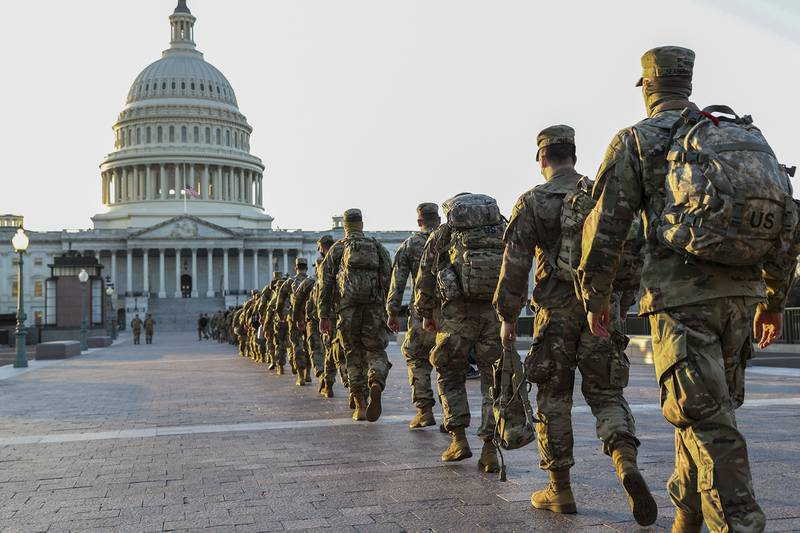 Members of the National Guard arrive at the U.S. Capitol on Jan. 12, 2021, in Washington.
