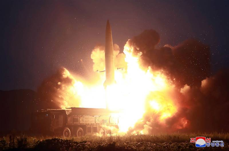 This Aug. 6, 2019, photo provided by the North Korean government shows the launch of a new-type of tactical guided missile at an airfield in the western area of North Korea.