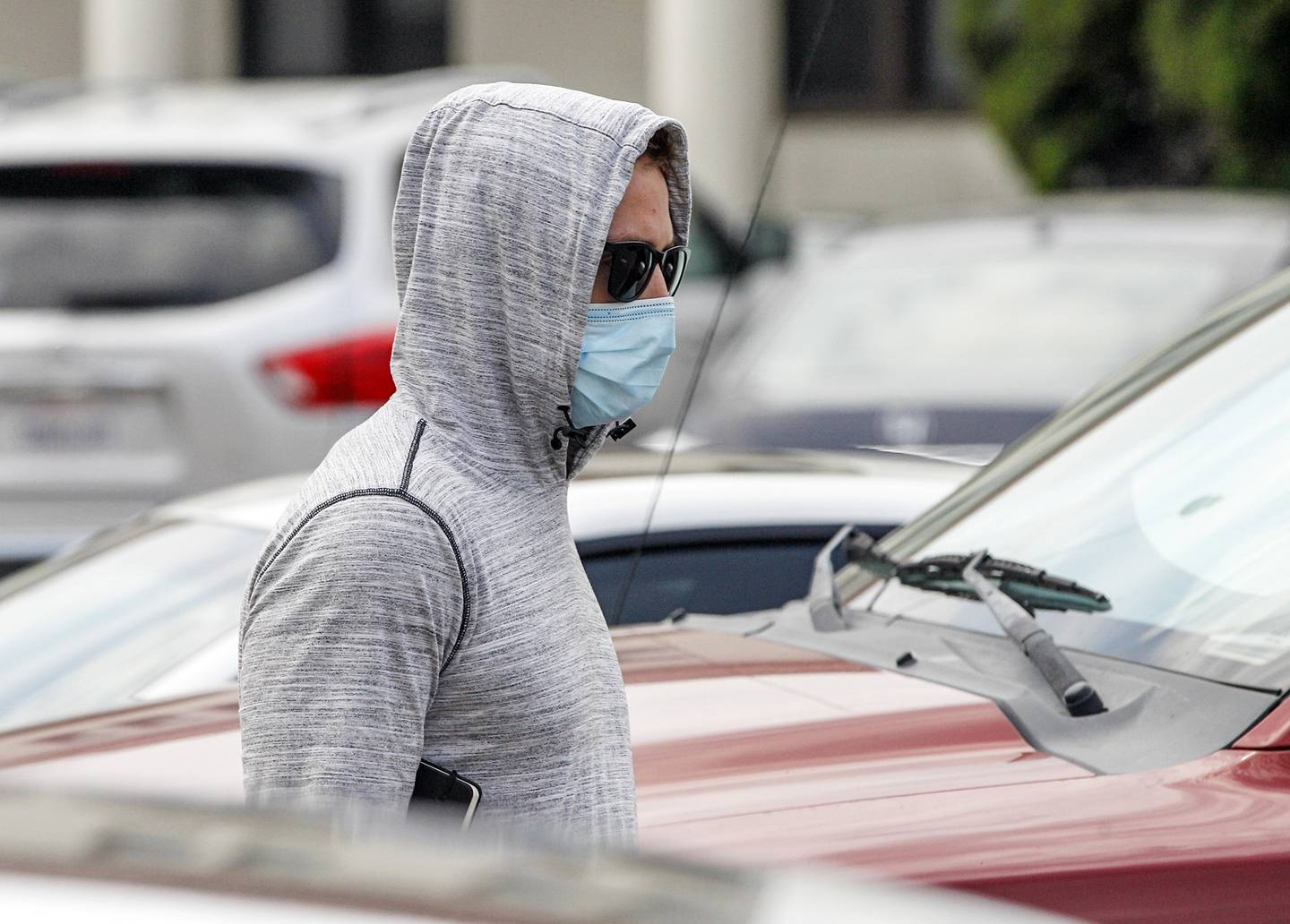 Petty Officer First Class Adel Enayat leaves the building after appearing for a hearing at Naval Base San Diego, Friday, Aug. 21, 2020, in San Diego.