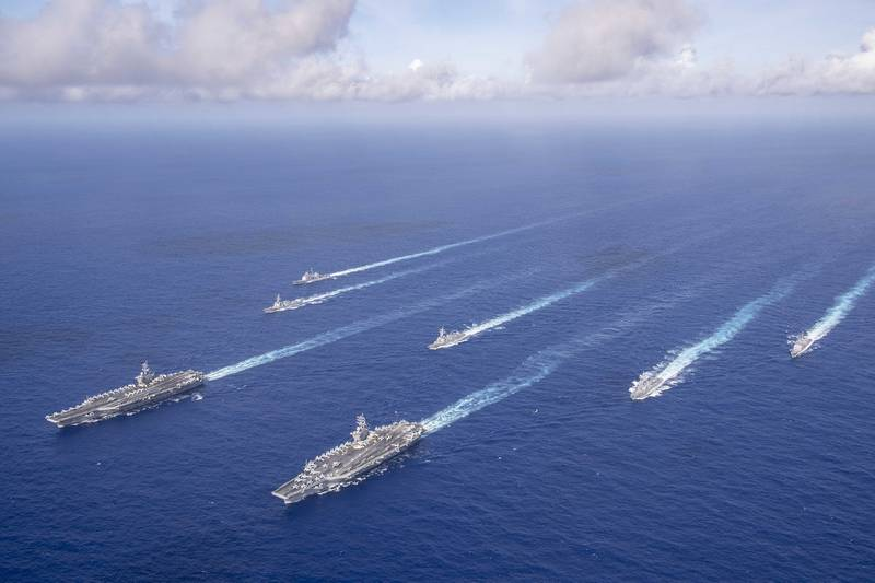 The Theodore Roosevelt and Nimitz Aircraft Carrier Strike Groups transit the Philippine Sea in formation while conducting dual carrier and air wing operations on June 23, 2020.