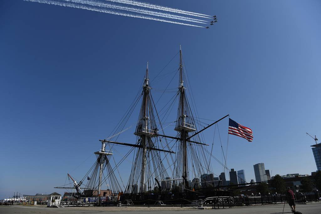 The U.S. Air Force Thunderbirds fly over the USS Constitution in Boston Harbor during a 'Salute to Great Cities of the American Revolution' on July 4, 2020. The Department of Defense conducted the flyover of Boston to recognize the role the city played in the birth of the nation.