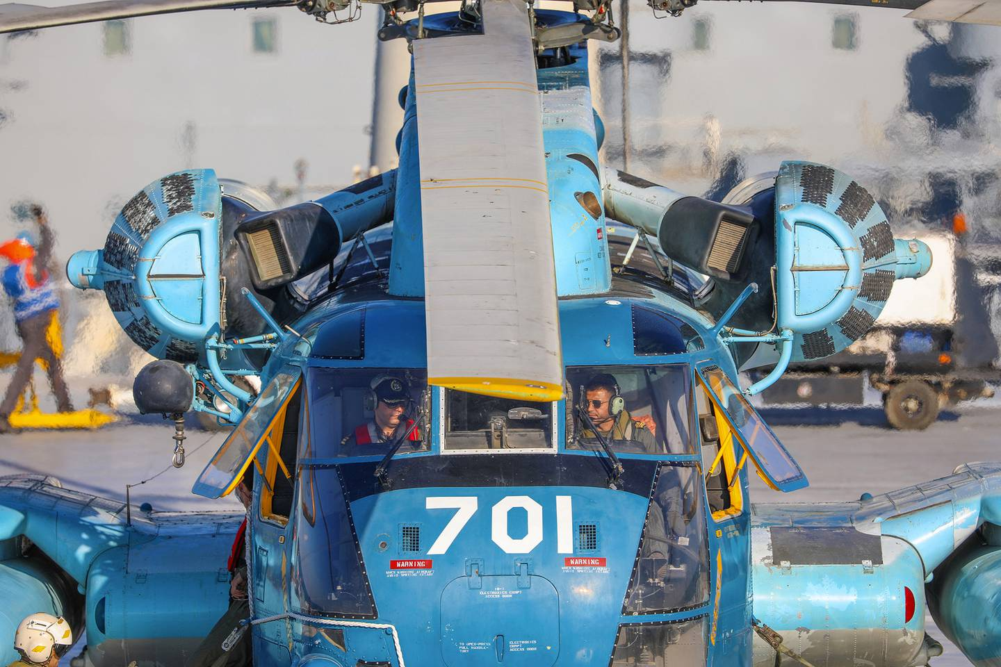 This image released Thursday, Jan. 14, 2021, by the Iranian Army shows a helicopter on an Iranian-made Makran logistics vessel during a naval drill.