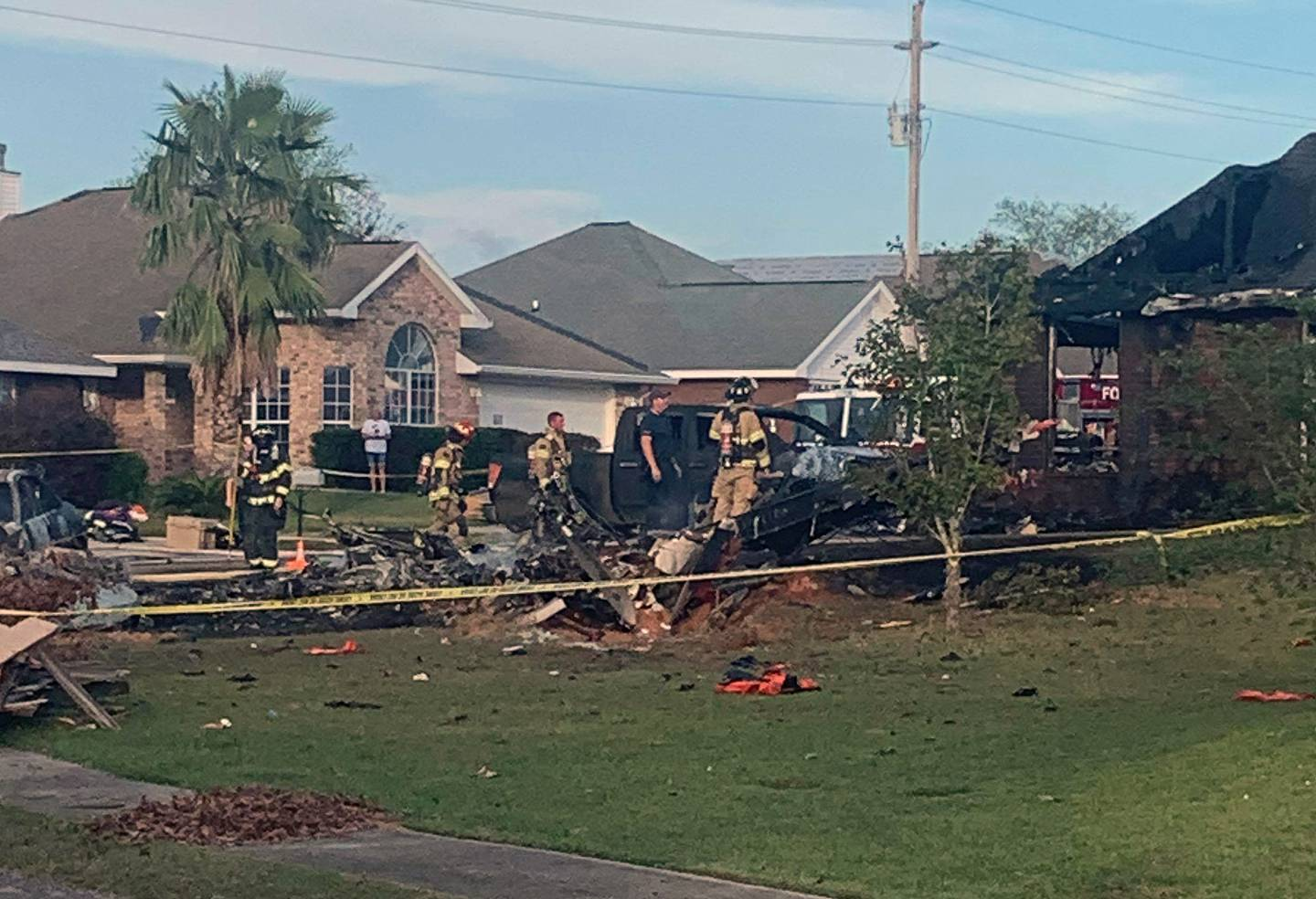 This photo provided by Greg Crippen shows the scene where a U.S. Navy training plane crashed in an Alabama residential neighborhood near the Gulf Coast, Friday, Oct. 23, 2020 near Foley, Ala.
