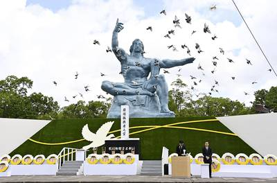 Doves fly over the Statue of Peace during a ceremony at Nagasaki Peace Park in Nagasaki, southern Japan on Aug. 9, 2020, to mark the 75th anniversary of the world's second atomic bomb attack.