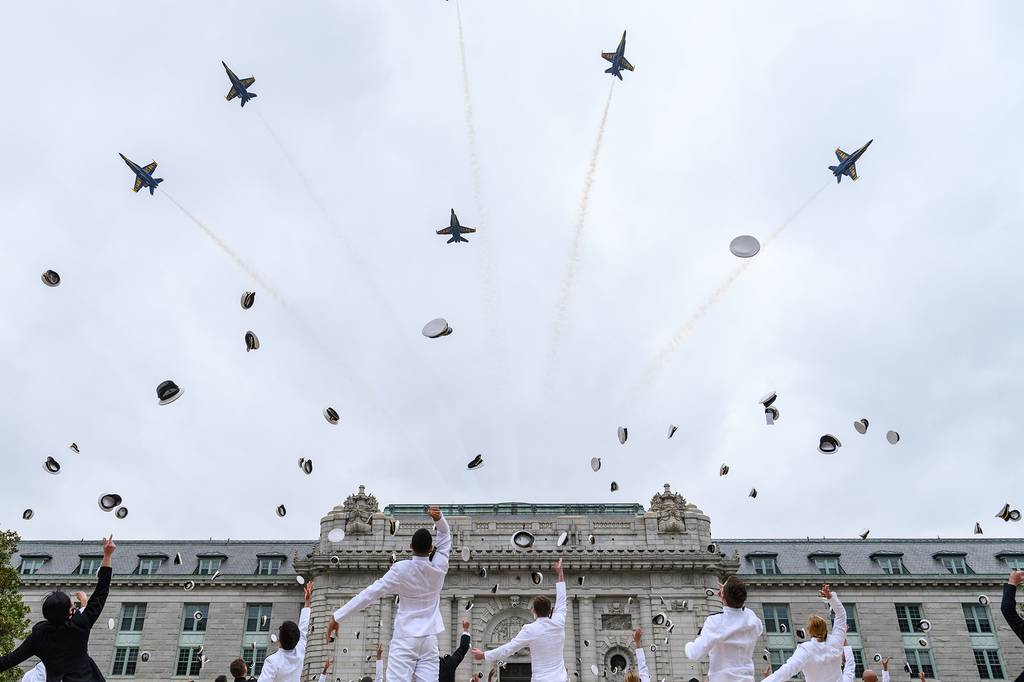 The U.S. Navy Flight Demonstration Squadron, the Blue Angels, fly over Bancroft Hall as midshipmen toss their covers concluding the fifth swearing-in event for the United States Naval Academy Class of 2020 on May 20 in Annapolis, Md.