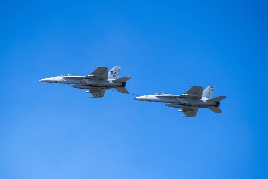 A Navy F/A-18 Super Hornet refuels one of its brethren earlier this year. (Navy)