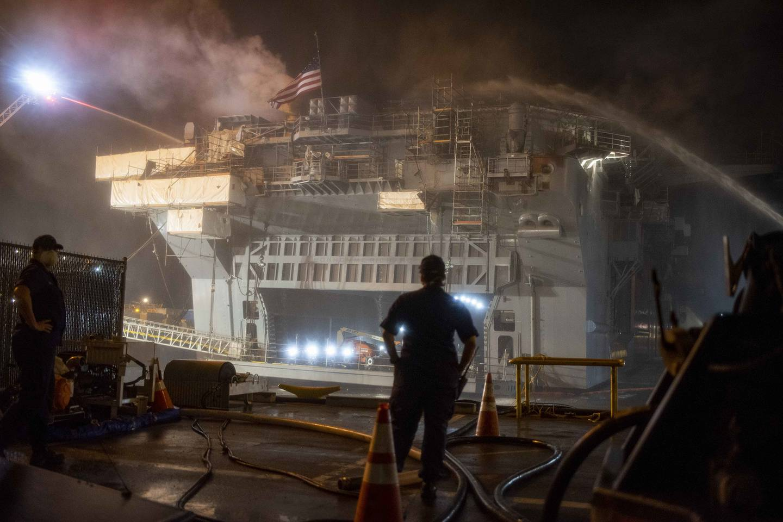 Sailors combat a fire aboard the amphibious assault ship Bonhomme Richard (LHD 6) on July 13 in San Diego.