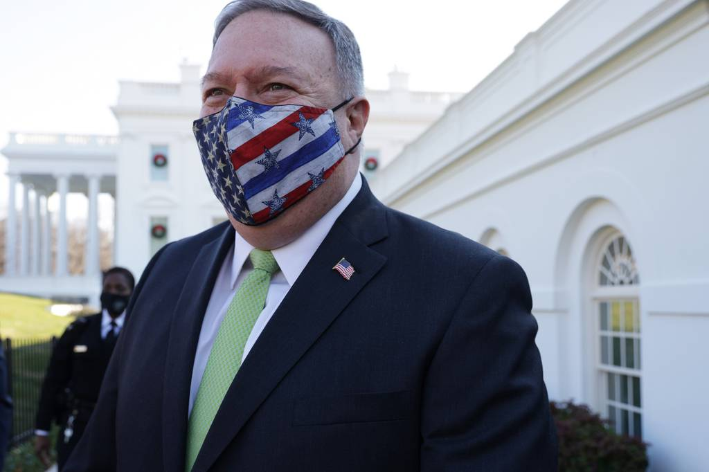 Secretary of State Mike Pompeo walks on the grounds of the White House Dec. 11, 2020, in Washington.