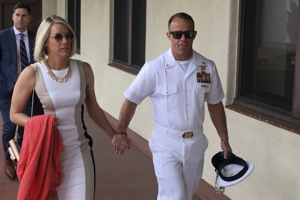 Navy Special Operations Chief Edward Gallagher, right, walks with his wife, Andrea Gallagher as they arrive to military court on Naval Base San Diego