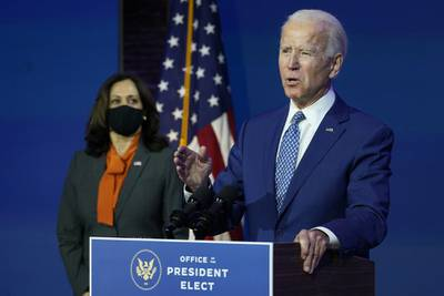 President-elect Joe Biden, joined by Vice President-elect Kamala Harris, speaks at The Queen theater, Monday, Nov. 9, 2020, in Wilmington, Del.