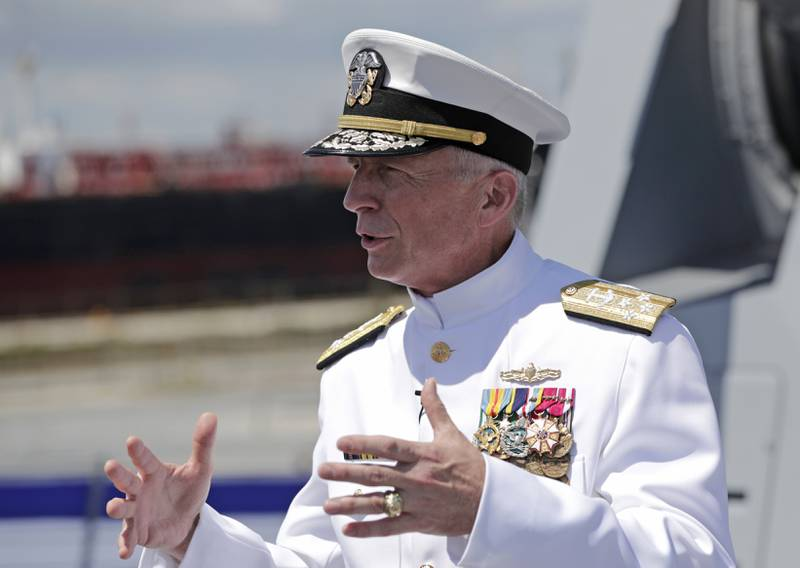 In this  July 27, 2019, file photo, Adm. Craig Faller, commander of U.S. Southern Command, speaks with the news media following a commissioning ceremony for the U.S. Navy's guided missile destroyer Paul Ignatius, at Port Everglades in Fort Lauderdale, Fla.
