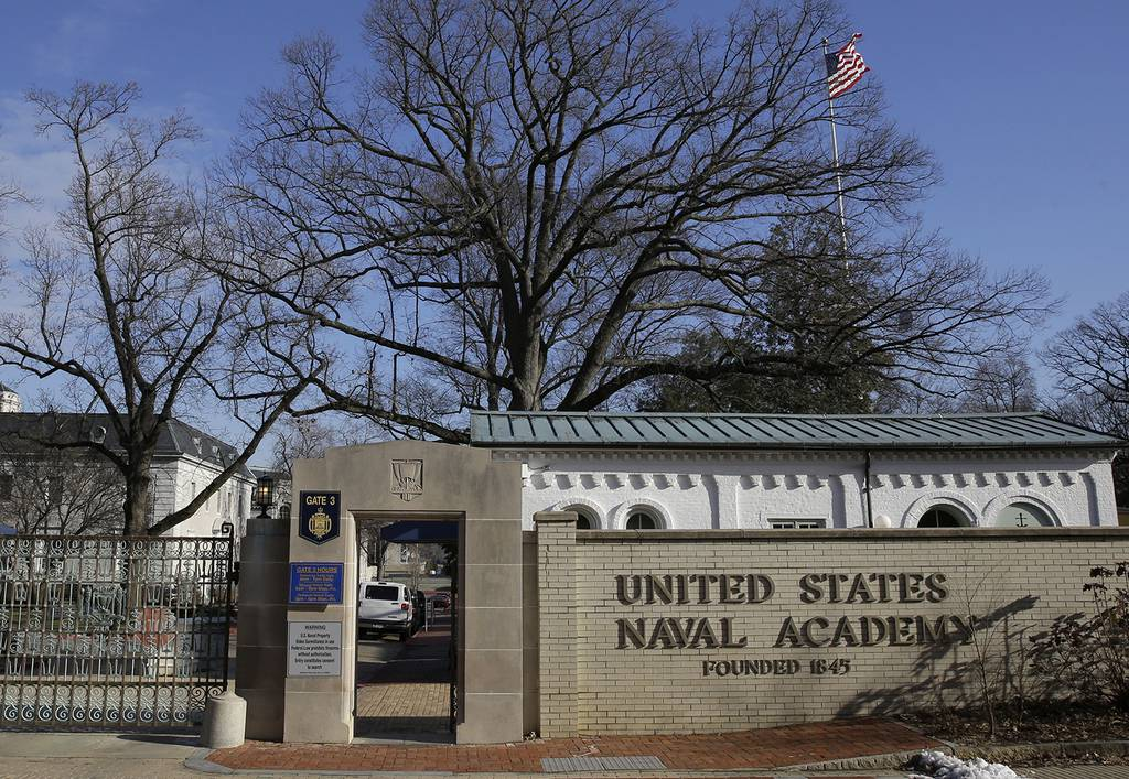 A sign stands outside of an entrance to the U.S. Naval Academy campus in Annapolis, Md., on Jan. 9,2014.