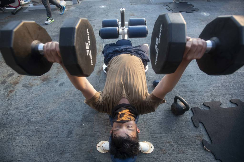 Boatswain's Mate Seaman Apprentice Esau Arellano, assigned to the Arleigh Burke-class guided-missile destroyer USS Ralph Johnson (DDG 114), engages in physical fitness while underway on Aug. 4, 2020, in the Arabian Gulf.