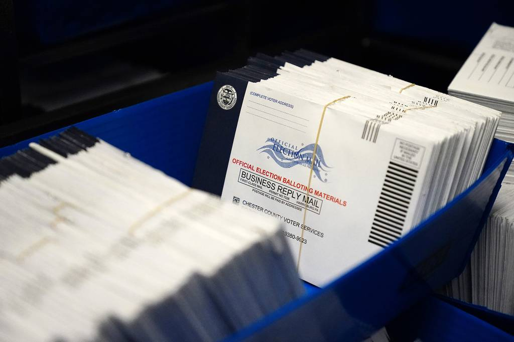 In this Oct. 23, 2020, file photo, mail-in ballots for the 2020 general election in the United States are seen after being sorted at the Chester County Voter Services office, in West Chester, Pa.