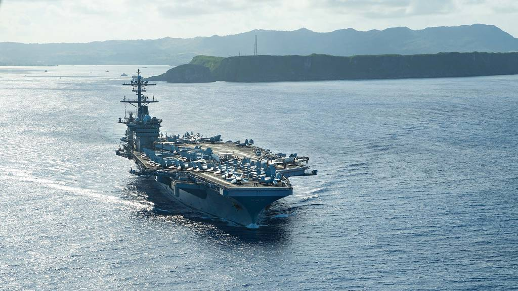The aircraft carrier USS Theodore Roosevelt (CVN 71) operates in the Philippine Sea May 21, 2020, following an extended visit to Guam in the midst of the COVID-19 global pandemic.