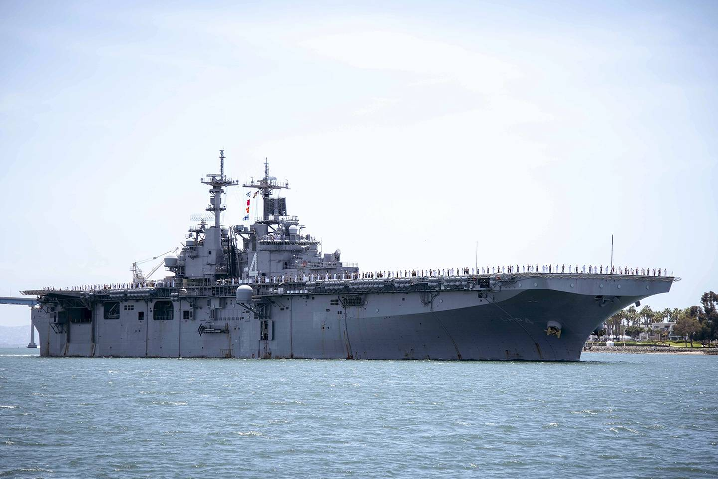 In this May 1, 2019, photo provided by the U.S. Navy, the amphibious assault ship USS Boxer (LHD 4) transits the San Diego Bay in San Diego, Calif.