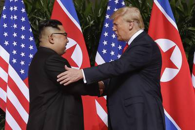 In this June 12, 2018, file photo, President Donald Trump, right, shakes hands with North Korea leader Kim Jong Un at the Capella resort on Sentosa Island in Singapore.