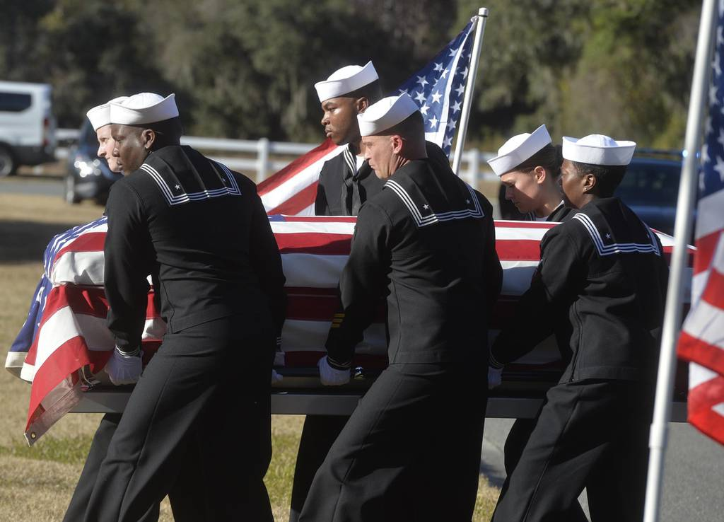 In this Dec. 16, 2019 file photo, sailors carry the casket of Cameron Walters at Oak Hill Cemetery in Richmond Hill, Ga.