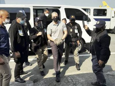 U.S. Marine Lance Cpl. Joseph Scott Pemberton, center, is escorted as he arrives at the airport before boarding a U.S. military plane in Manila, Philippines, Sunday, Sept. 13, 2020.