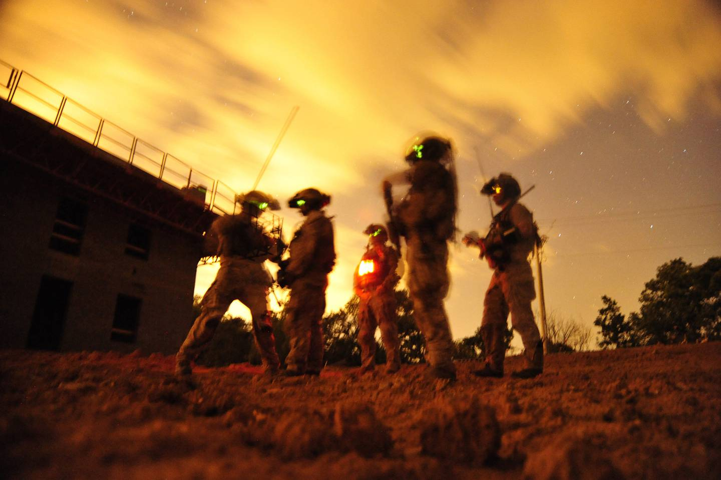 In this 2012 photo made available by the U.S. Navy, a squad of Navy SEALs participate in special operations urban combat training at an undisclosed location.