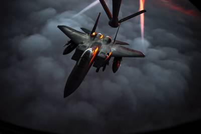 A U.S. Air Force F-15E Strike Eagle departs after receiving fuel from a U.S. Air Force KC-135 Stratotanker during an air refueling mission over Southwest Asia, Dec. 22, 2020.